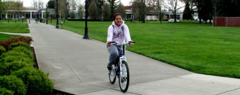 Tess Haglelgam frequently rides heir bike to and from Nicholson Library.  Photo by Justin Derby, Sports reporter