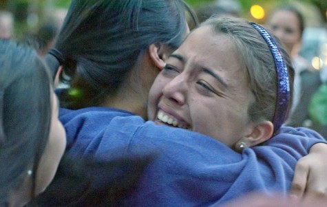 Freshman pitcher Shelby VandeBergh celebrates her team's May 24 return to campus with congratulatory hugs. The Wildcats secured the national title that morning when they defeated the Christopher Newport University Captains 6-2.