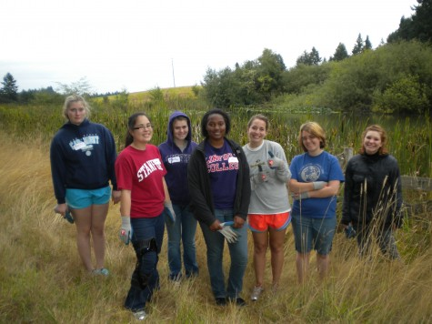 A group of students volunteer at Miller Woods, doing their part in serving the community as well as participating in an annual campus event Sept. 17. Photo courtesy of Kit Crane