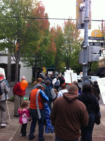 Locals march through downtown McMinnville.