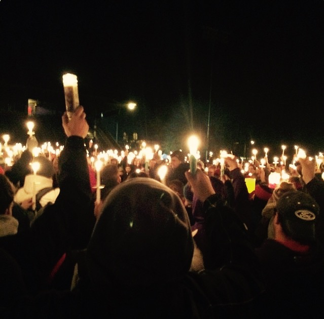 Students+raise+their+candles+up+toward+the+night+sky+in+loving+memory+of+Parker+Moore.