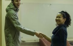 Current ASLC president Nathan Pellatz shakes hands with Tenzin Yangchen,