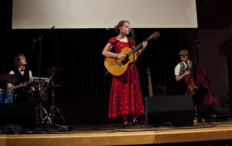 Performers of the touring Muses's Market play live music focused on sustainability and environmental issues during an April 20 Earth Week event in Ice Auditorium. Megan Myer/Online editor