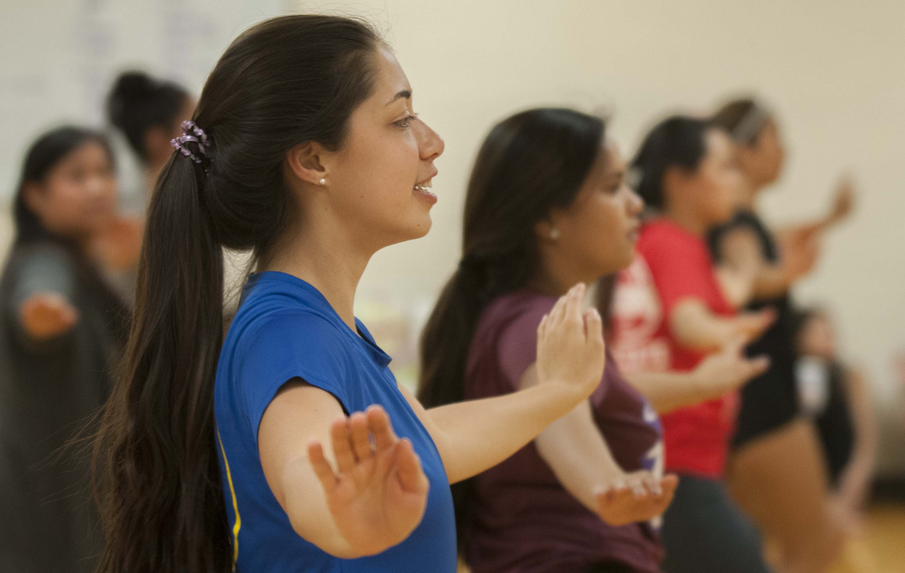 Rachel Richardson, '18, leads by example from the front, rehearsing a Hula to be performed at the 44th annual Lu'au.
