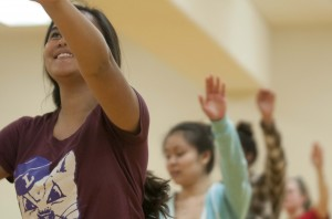 Kiana Sniffen, '18, one of the students in charge of teaching the performance, leads the group through the routine.