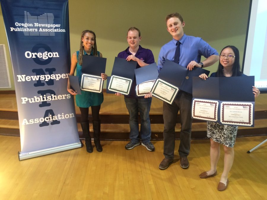 Sports editor Kaelia Neal, Editor-in-Chief Jonathan Williams, Assistant editor Ross Passeck and News editor Elizabeth Stoeger hold up the Review's awards at the Oregon Newsaper Foundation awards day on May 13 at the University of Oregon.