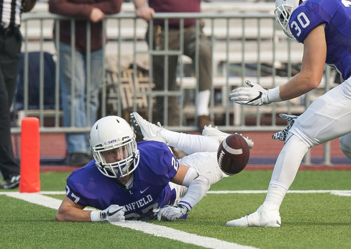Linfield's Keegan Weiss just fails to down a 48-yard punt by Colton Ramos inside the 1-yard line in the Wildcat's final drive of the third quarter. Mary Hardin-Baylor led 17-3 at the time and won the game 24-3.