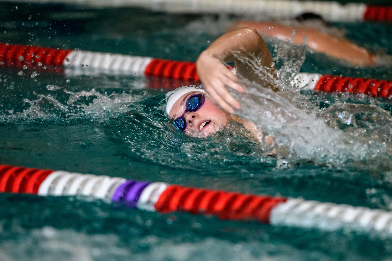 Claire St. Marie, '19, swimming the 1000m freestyle against Lewis & Clark.