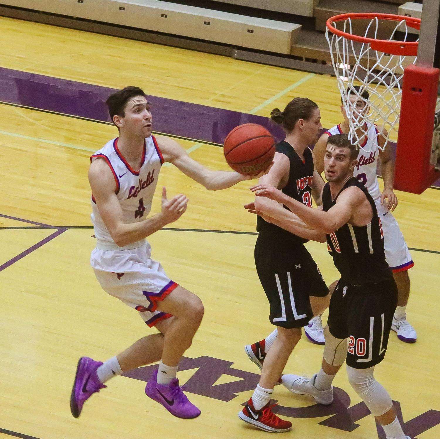 Dempsey Roggenbuck, '21, going up for a layup at a previous game