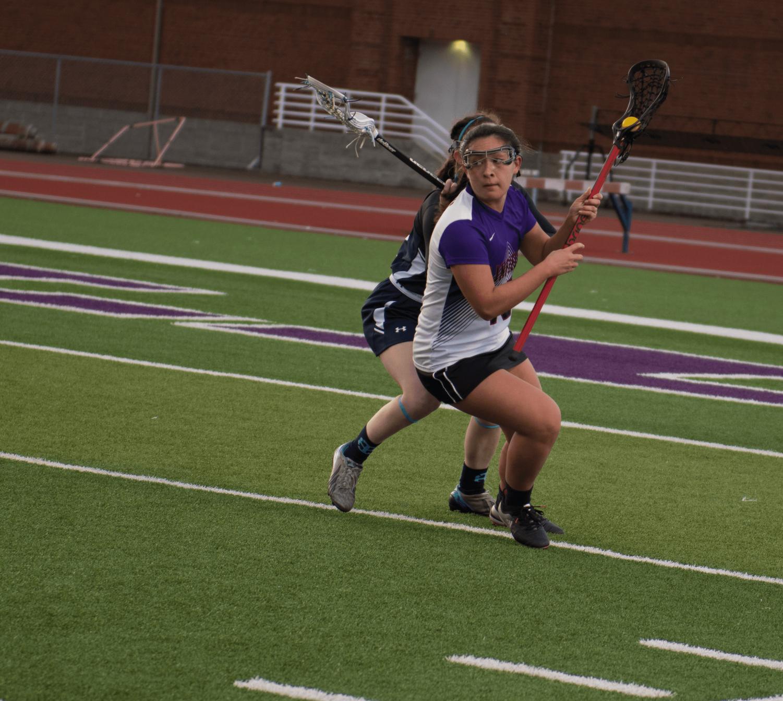 Freshman Gabriella Moe evades a St. Mary's defender