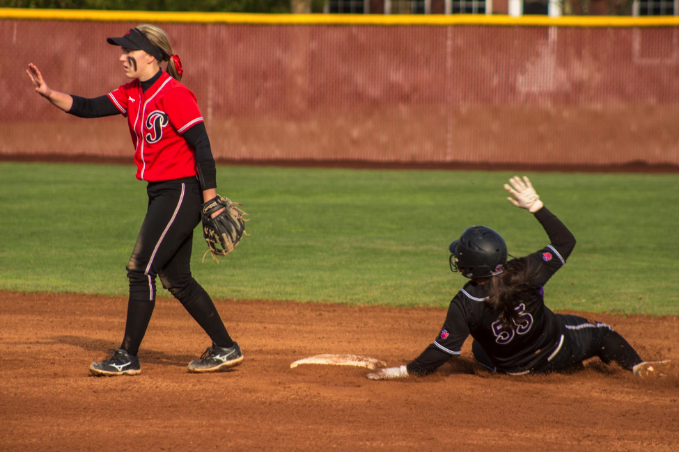 Chelsea Horita, '20, (#55) slides past Pacific second baseman Trisha Snyder for the steal.