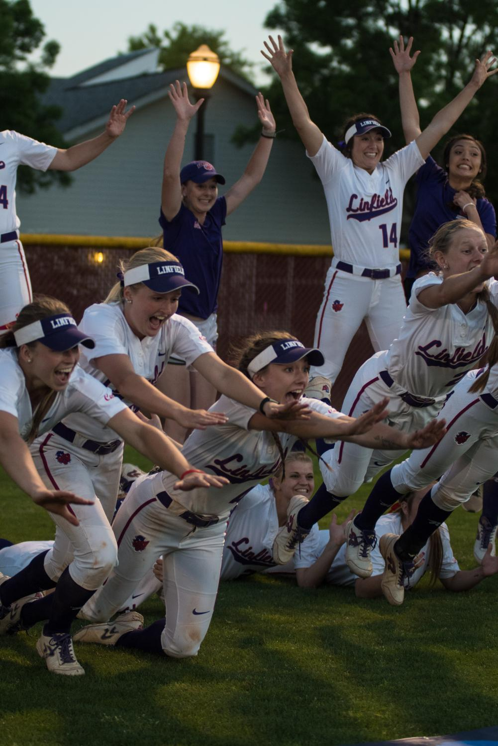 The Wildcats sliding into an after championship team photo.