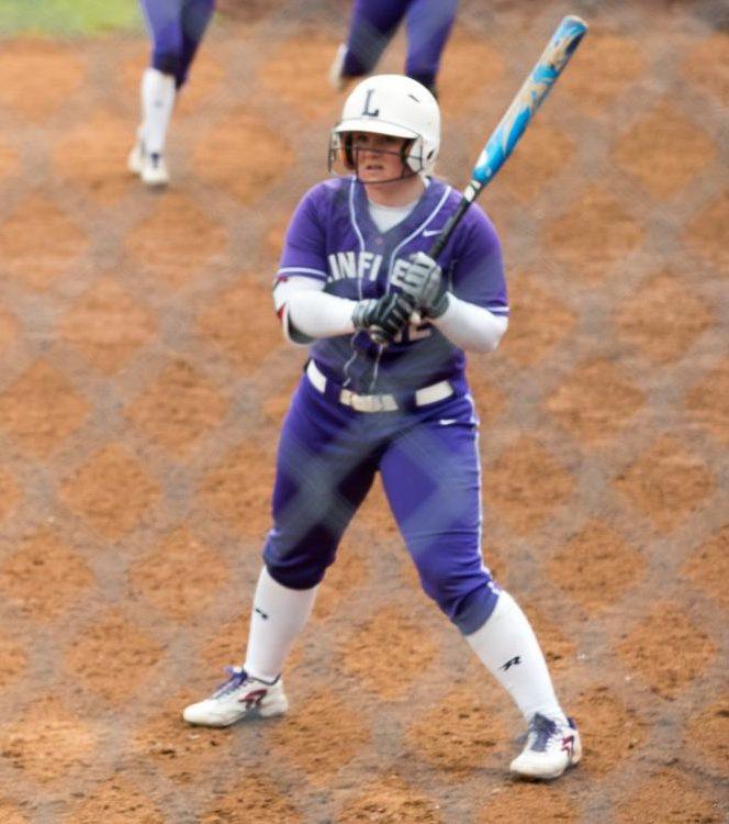 Senior Melanie Oord at bat in a home game.