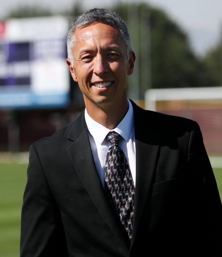 Steve Simmons stands on the grass field used by Linfield's soccer and lacrosse teams.