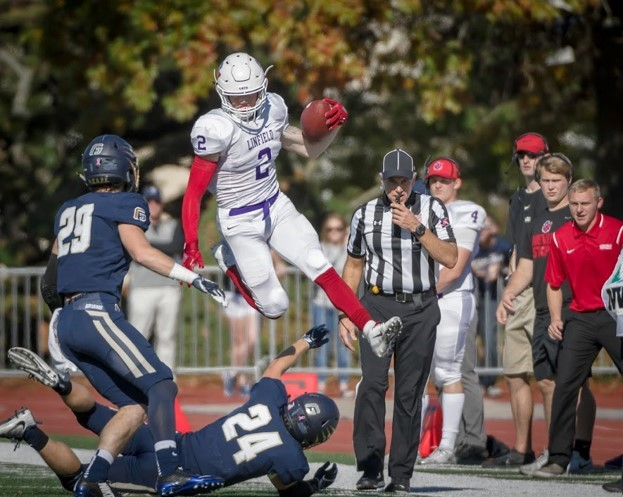 Linfield wide receiver J.D. Lasswell makes a first-quarter catch for eight yards and a first down as the No. 24-ranked Wildcats defeated the George Fox Bruins 14-0 Saturday in Newberg for the team's third consecutive win. Lasswell led Linfield's receivers with five receptions for 36 yards.