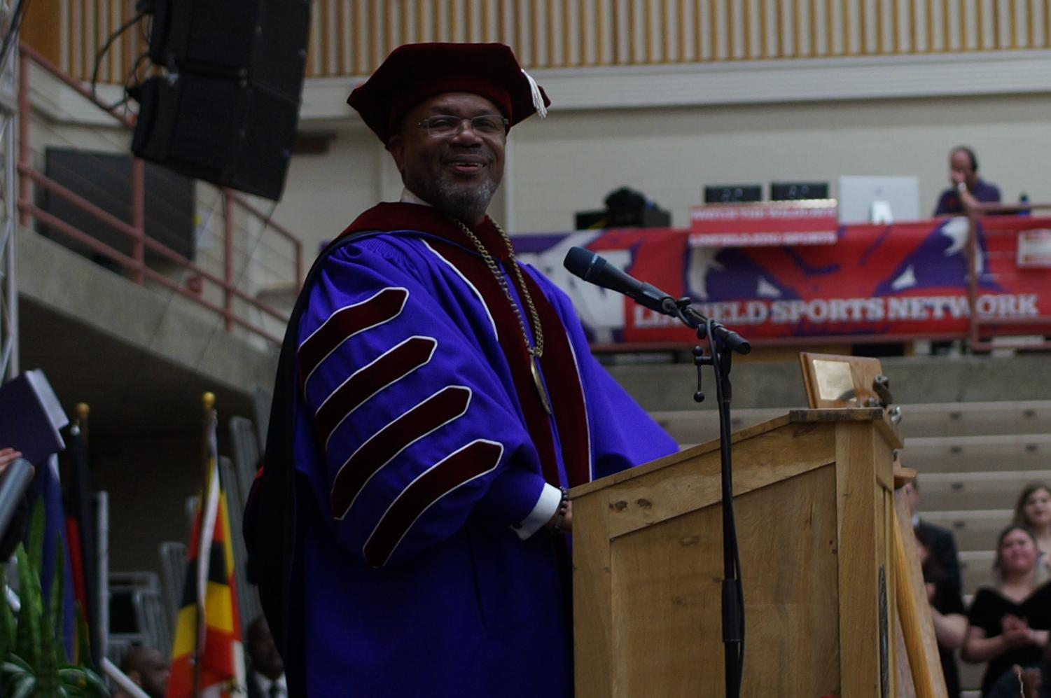"""Vanessa Kelly   President Davis asks the crowd, """"What team?"""" after becoming the official 20th president of Linfield College. During his speach Davis emphasized that it is imperitive to protect the liberal arts."""