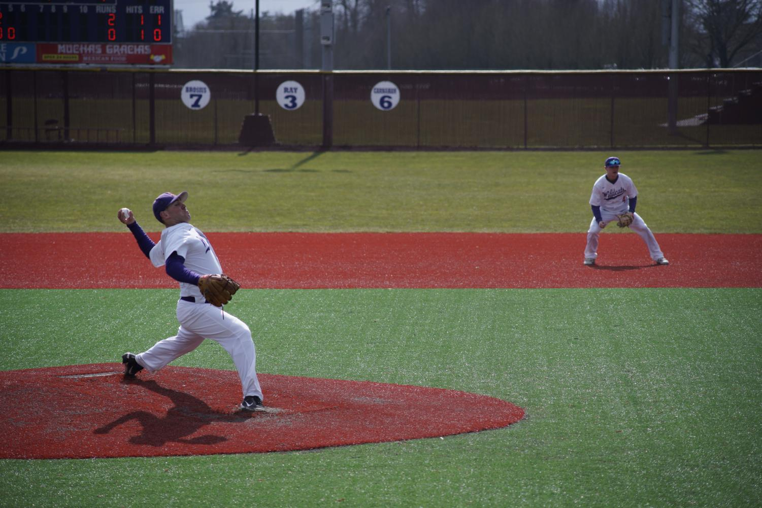 Cason Cunningham, '19, winding up his pitch in game one of the Willamette Bearcats series with Alec Cook, '19, on first base.