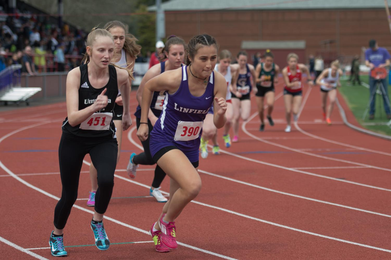 Anne Ferguson, '19, jolting of the line for the 800-meter.