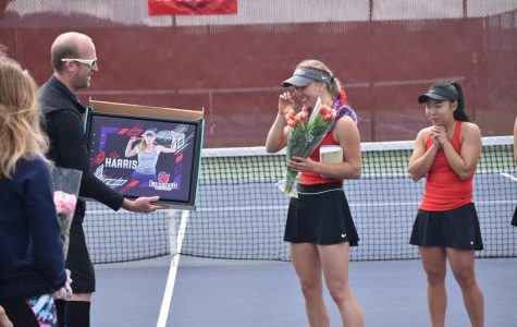 Elsa Harris receiving a senior award from coach Carl Swanson.