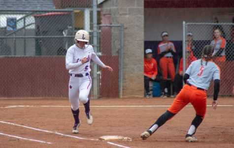 Kelsey Wilkinson, '20, successfully making it to first base with time to spare.