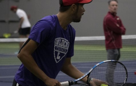 Nathan Saragoza, '19, plays in his last doubles match with Luis Rojas, '20 here at Linfield and wins in a close match against Willamette.