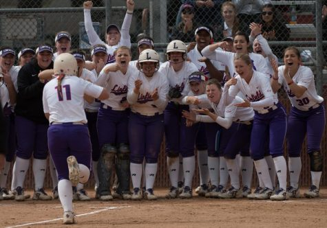 Team celebrates Paige Smotherman, '19, running home after jacking a 2-run homer over right-center field, making the score 7-0.