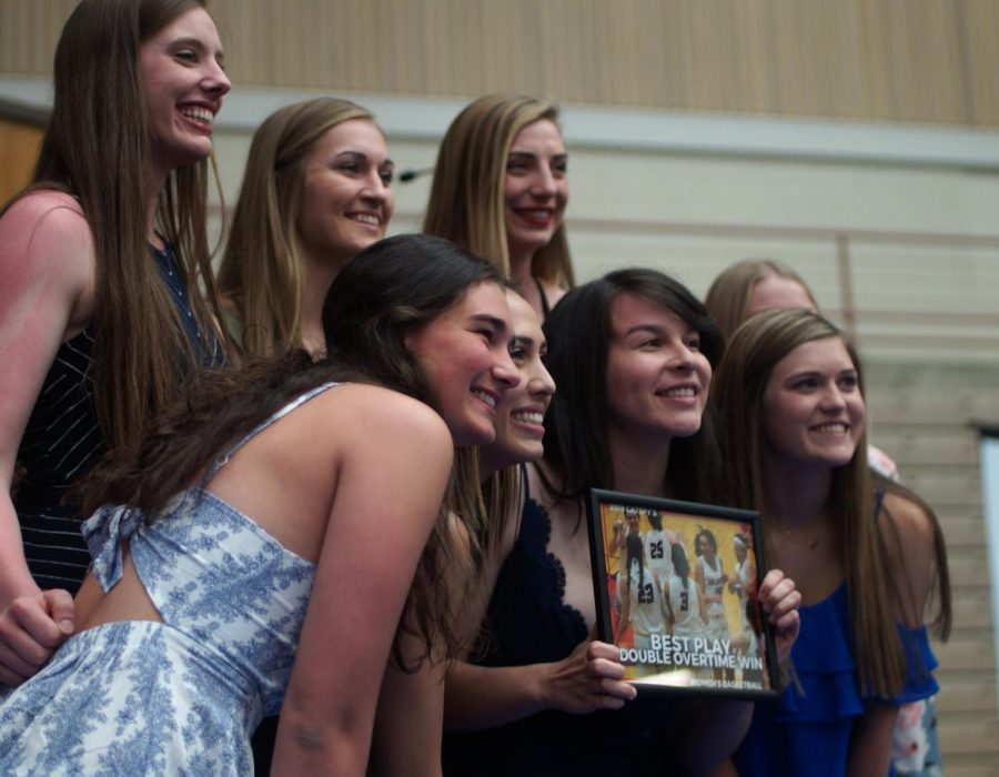 Women's basketball team wins Play of the Year Award for their win over UPS in double overtime.