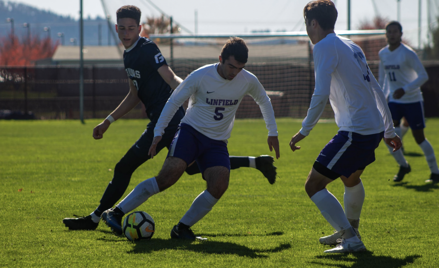 Ryan Kister fights for possession of the ball