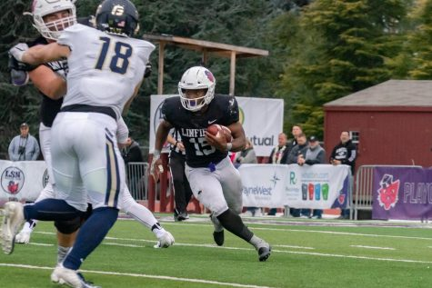 Sophomore running back Artie Johnson rushing during win over George Fox.