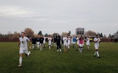 The men's team walks across their home turf for the last time during their 2019 season after the final whistle to greet their friends and family. Senior Henry Rosenfeld runs ahead to hug a former teammate on the sidelines.