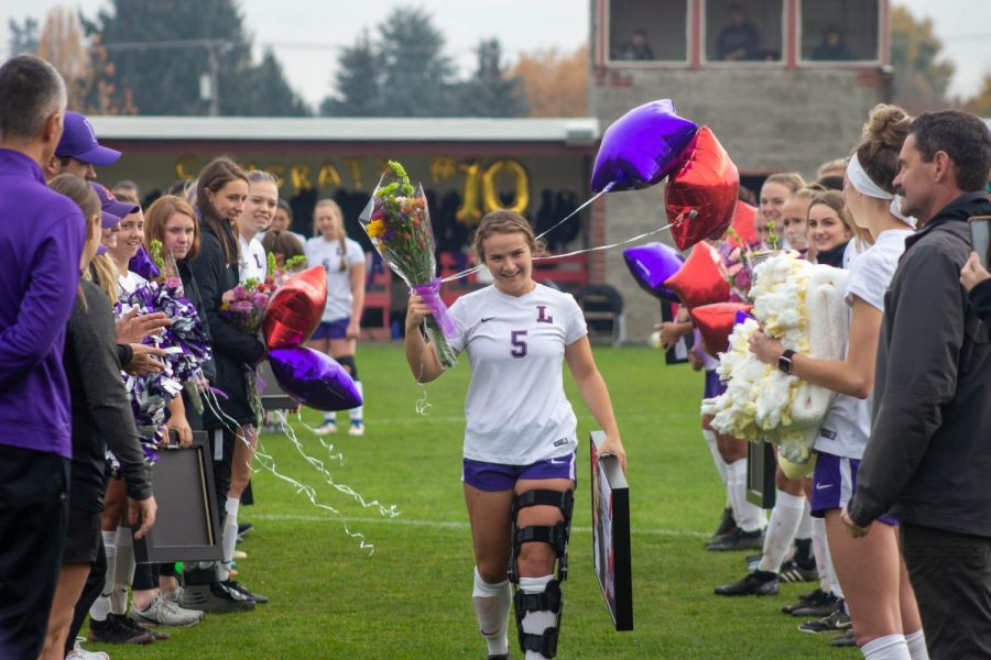 Senior+Lauren+Frost+walking+down+the+field+for+her+final+soccer+game+at+Linfield+College.%0A