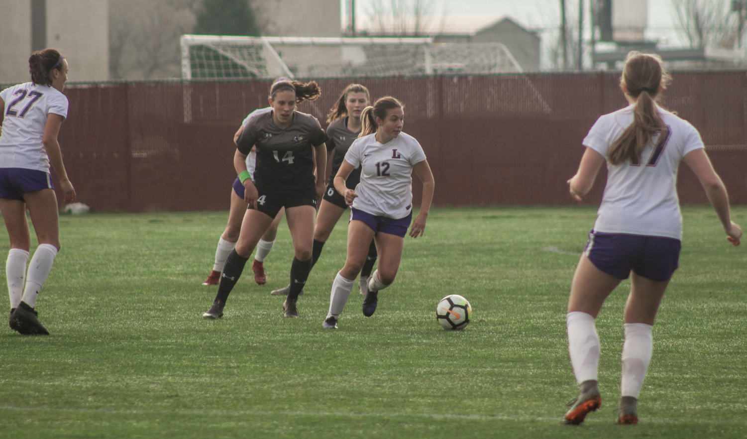 Taylor Cole dribbles around her defender
