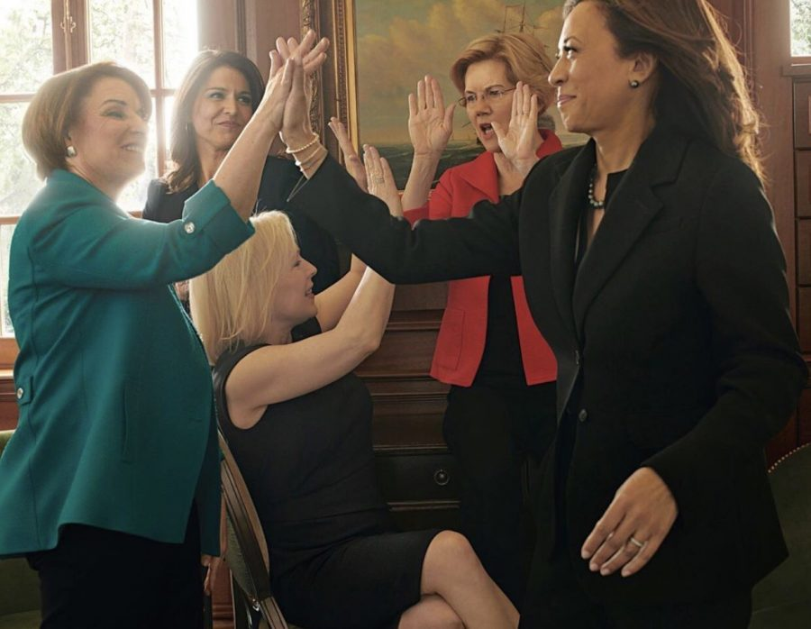 Five of the female presidential candidates pass around some high-fives