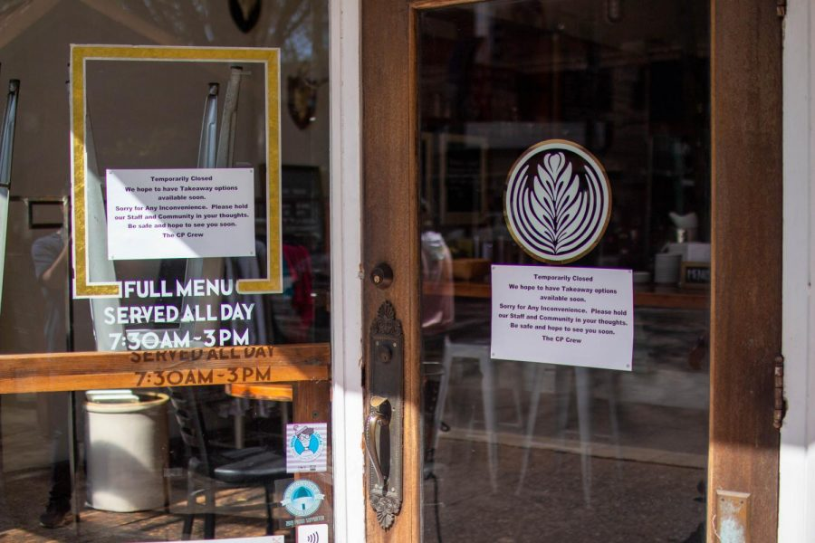 Community Plate, a popular hangout restaurant, hangs a sign on the door saying they are temporarily closed but hopes to have food available for takeout soon. Wednesday, April 8, 2020.