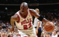 Michael Jordan in Bulls jersey with basketball in hand
