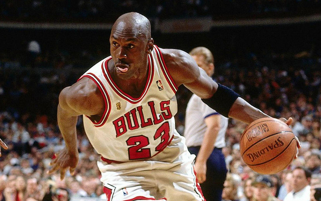 Michael+Jordan+in+Bulls+jersey+with+basketball+in+hand