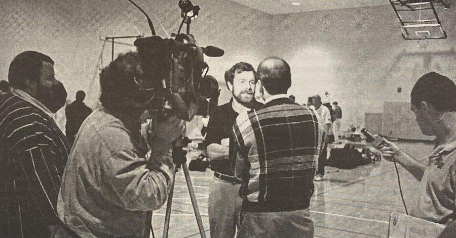 Portland Trailblazer coach P.J. Carlissimo speaks to the media in the upper gym.
