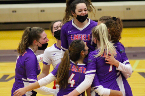 Sophomore Raelynn Hammock jumps to embrace teammates.