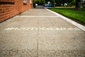 Sidewalks around campus were filled with chalk drawings in protest of Professor Daniel Pollack-Pelzner's termination.